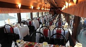 Image of dining inside a train car.