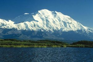 Image of a snowy mountain beyond river