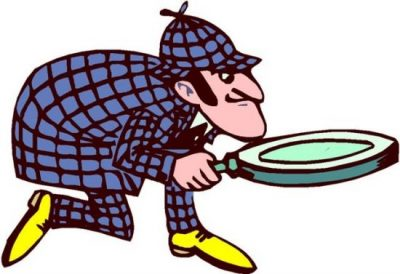 Image of detective looking through magnifying glass