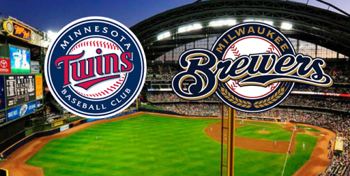 Image of Brewers and Twins logos over outfield