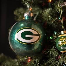 Image of Green Bay Packer ornament hanging on Christmas tree.