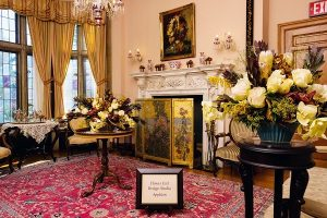 Image of room decorated with floral arrangements and art.