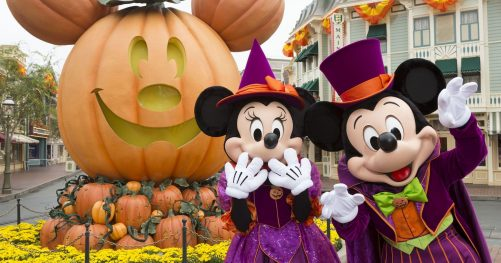 Image of Mickey & Minney Mouse with giant jack o' lantern