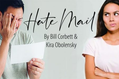 Image of a man and woman reading mail.